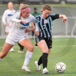 Junior Cate Nearmyer fights go gain control of the ball. Photo by Luke Hoffman
