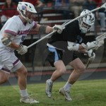 Junior Will Mohr's defender checks him on the head to try to get the ball. Photo by Noelle Griffin