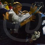 Seniors Andy Maddox and Ryan Anderson congratulate senior Tyler Stottle after the game ended. Photo by Noelle Griffin