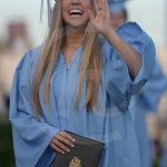 Senior Maggie Gray waves to her family in the audience. Photo by Reilly Moreland