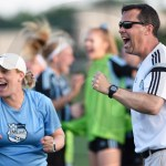 Coach Flett and Coach Kelly celebrate after East scores their second goal. Photo by Trevor Paulus