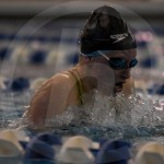Freshman Maeve Linsoctt races in the 100 yard breaststroke. Linscott finished in fifth with a finals time of 1:07.39. Photo by Kate Nixon
