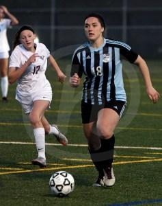 Junior Karoline Nelson looks up before sending the ball to junior Caroline Chisholm. Photo by Kate Nixon