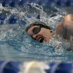 Junior Ashleigh Espinoza takes a breath during the 200 yard freestyle. Espinoza finished fourth with a finals time of 1:56.35. Photo by Kate Nixon