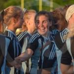 Sophomore Jilli Foley embraces a teammate minutes after the team won. Photo by Elle Karras