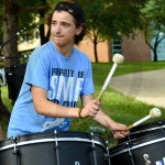 Senior Ben Attebery looks toward the conductor as he plays the drums. Photo by Annakate Dilks