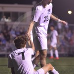 Senior Jack Slaughter helps up senior Simon Zimmerman during the end of the second half. Photo by Sarah Golder