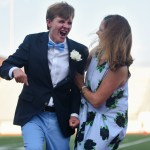 Senior Jack Waters celebrates with his mom after being named homecoming king. Photo by Aislinn Menke