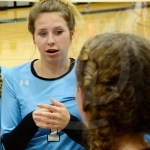 Sophomore Katie Heckman talks to a team member about strategy.