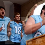 Varsity football team captains cheer during the pep rally. Photo by Megan Biles