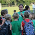 A Brookwood teacher talks to students as games of tag weave between and around them. Photo by Ben Henschel.