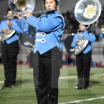 Junior Ragan Dutcher plays flute during the halftime show. Photo by Kate Nixon