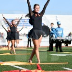 Senior Ellie Brown poses during a pause in the halftime show. Photo by Kate Nixon