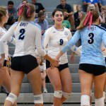 After winning the point, Senior Brigid Wentz celebrates and high fives her teammates. Photo by Elise Madden