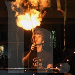 Junior Graham Billingsley lights a ballon to mark the start of Mole day. Photo by Trevor Paulus