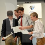 Freshman Hassan Sufi, Junior Lewis Muehlberger and Alex Martin laugh at their certificates awarded to them. Photo by Elise Madden