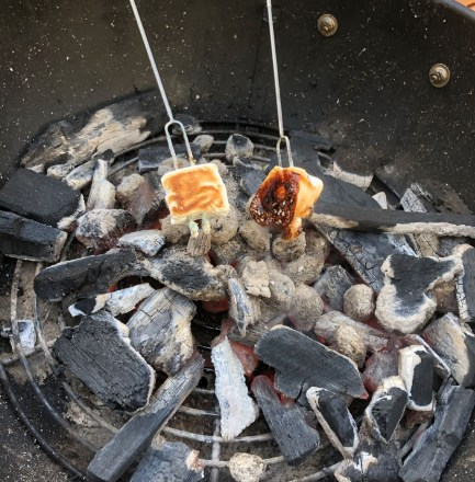 Roasted homemade Campfire Marshmallow over charcoal