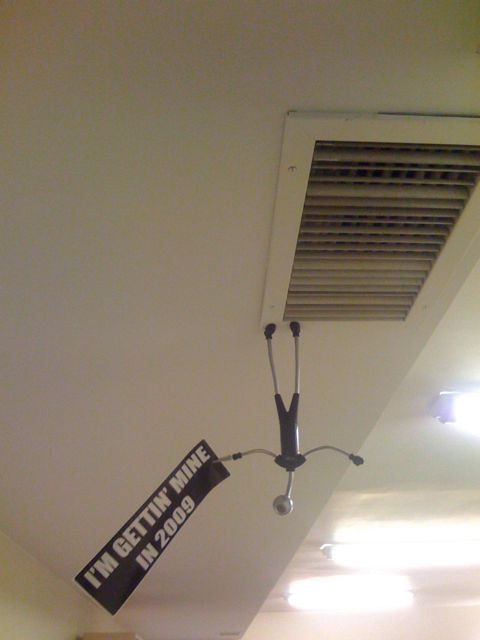 I come back from two days out sick and find this hanging from the ceiling in the office. It's a long story.