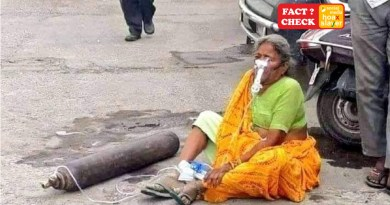 A 3 year old photo of an old lady sitting on the road wearing an oxygen mask with cylinder beside her is viral now