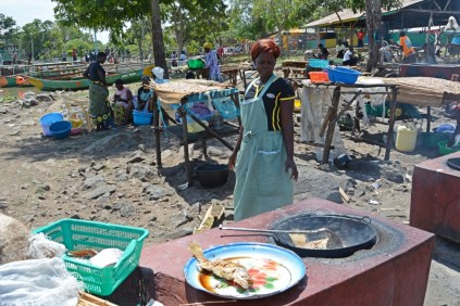 Woman frying fish