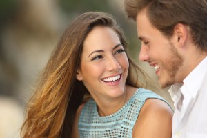 Couple with a great smile after orthodontic treatment.