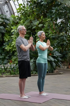 couple practicing yoga