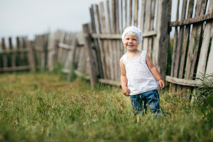 cute little girl and wooden fence portrait