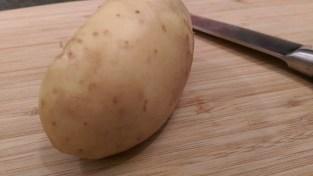 Potato set on newly cut bottom
