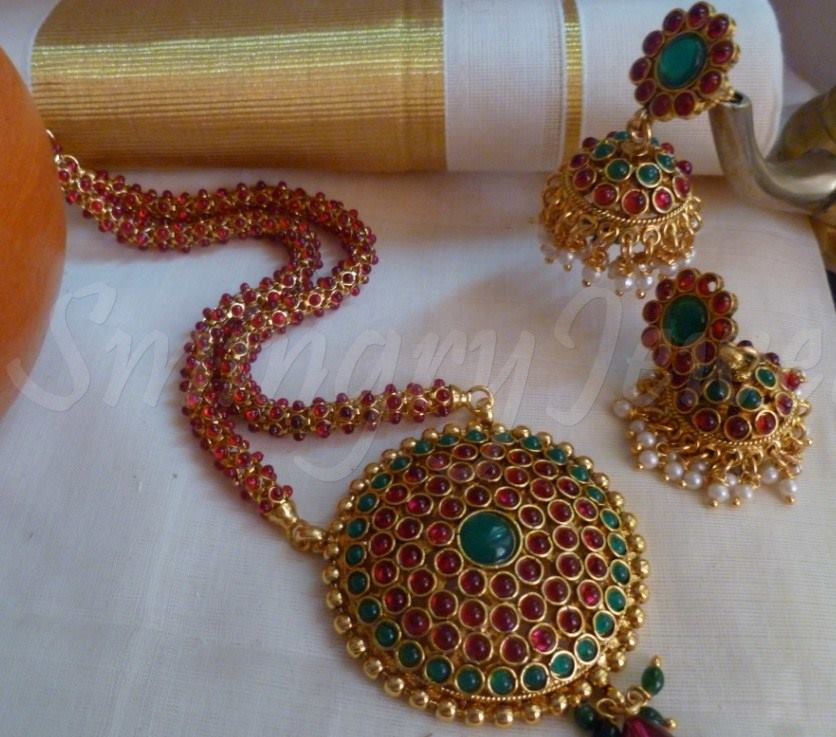 Red  and gold plated  Kemp Long Haram  necklaces and Jhumka