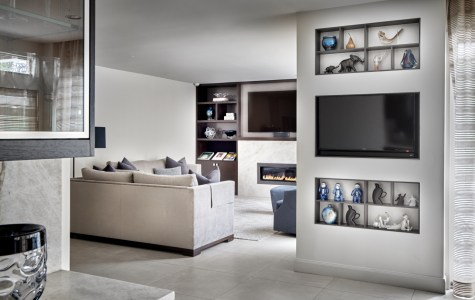 built-in television in family room and kitchen