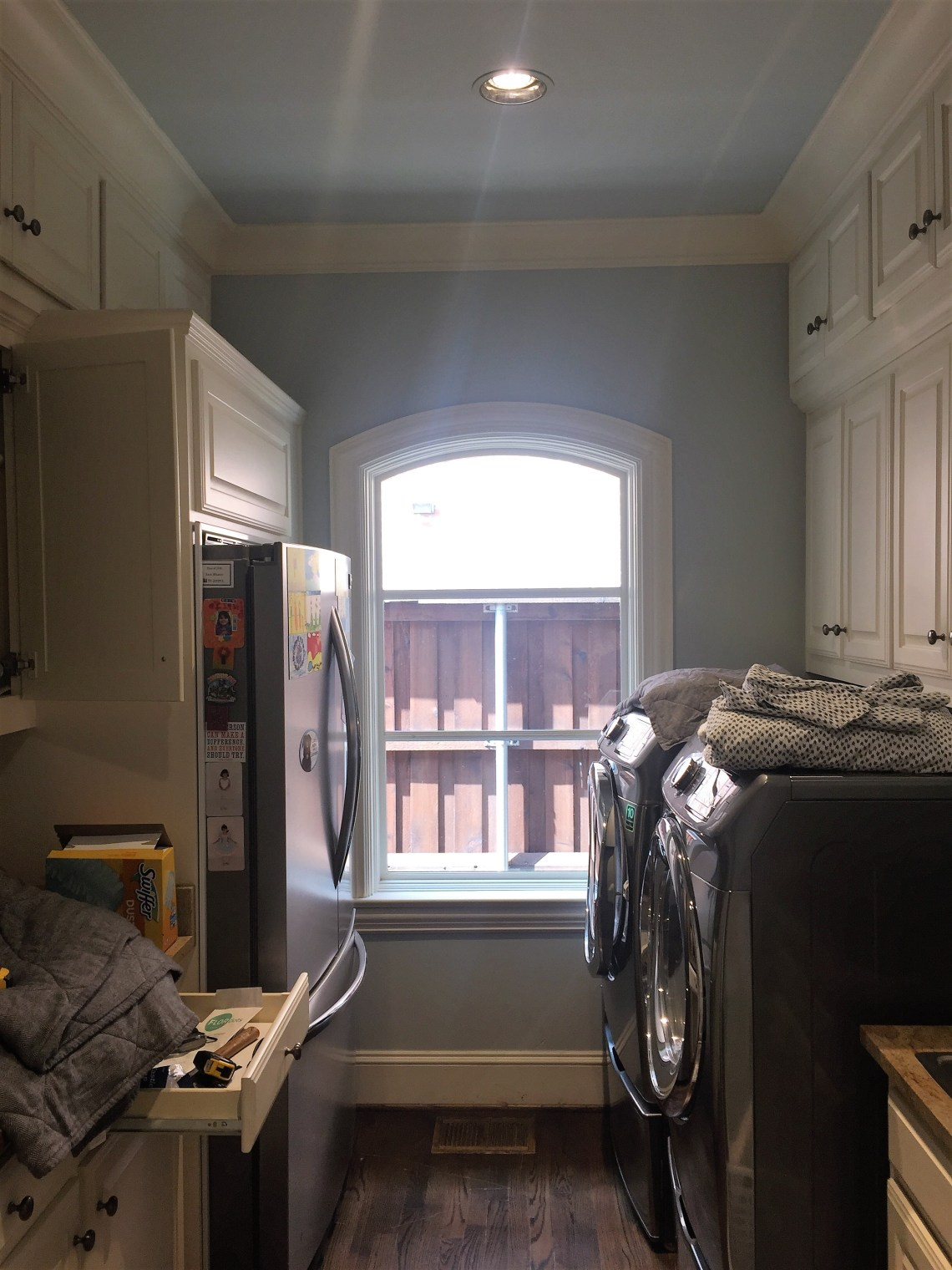 before and after photo of laundry room renovation