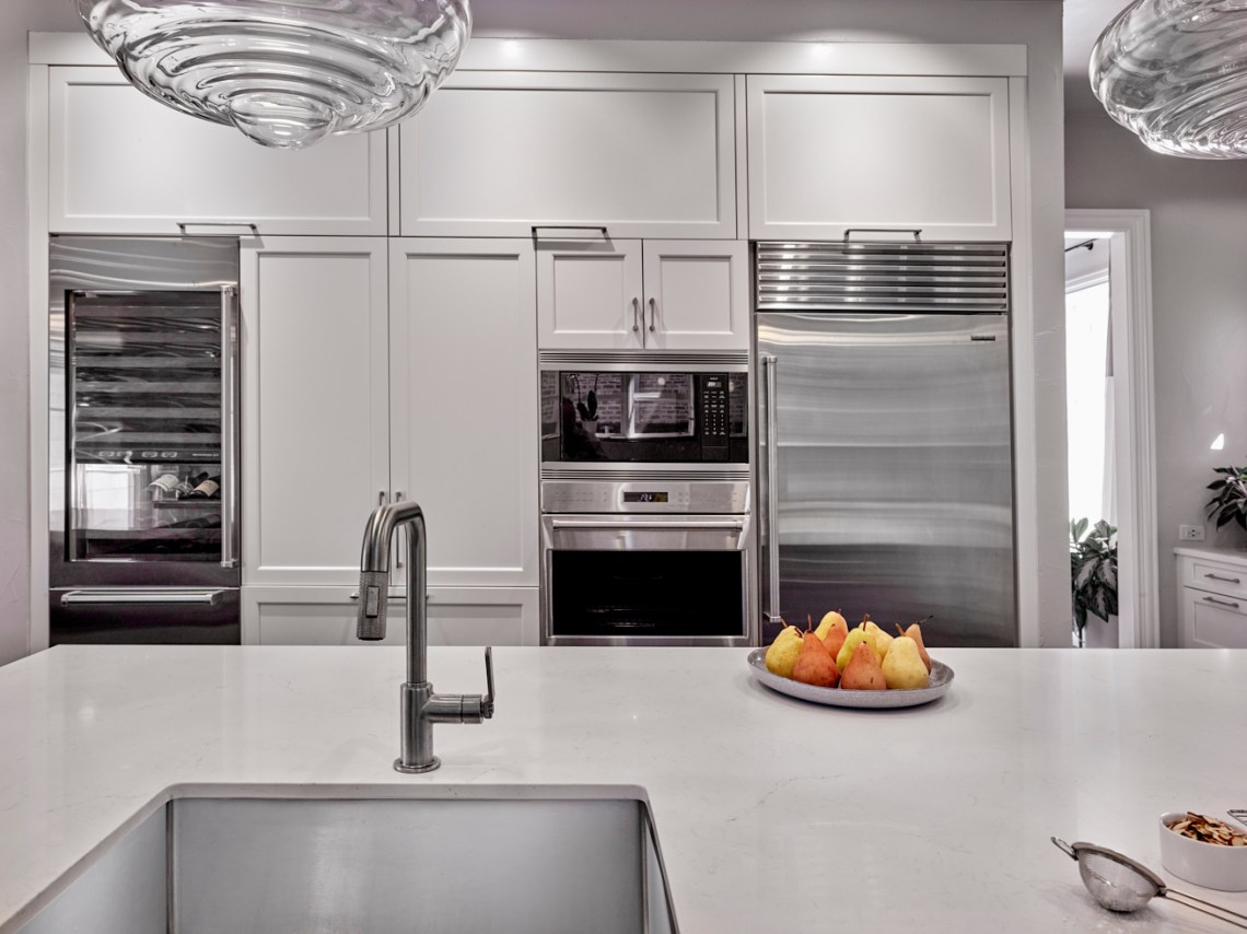 sub-zero and wolf appliance wall with tall pantry