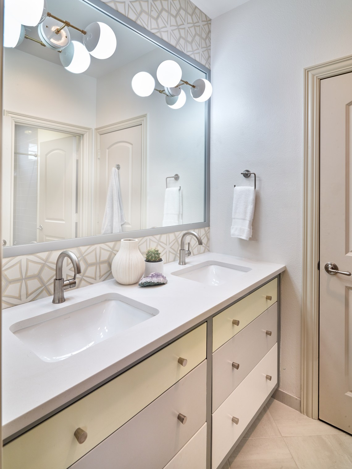 Kids bathroom with colorful painted cabinetry and cement tile backsplash with Cedar & Moss lighting