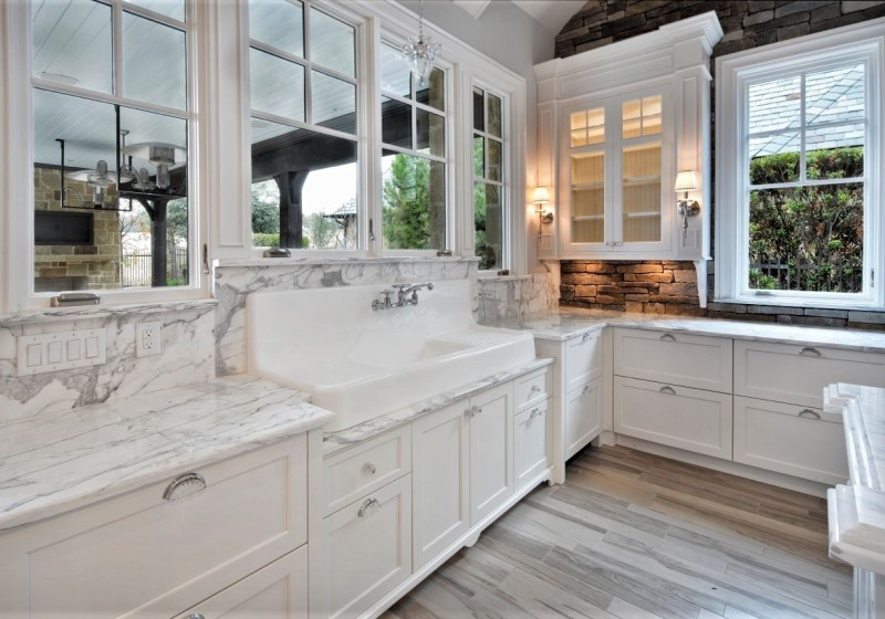 traditional white kitchen with large farm sink