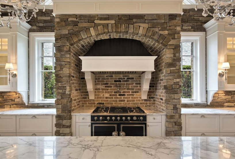 traditional white kitchen with la cornue range