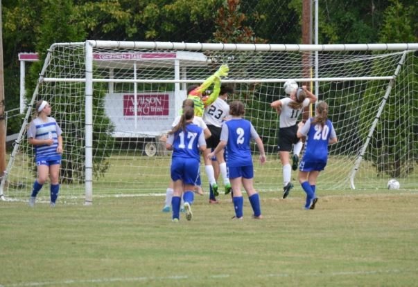 Alyssa Williams and Majala Harrelson attempt to score off a corner kick
