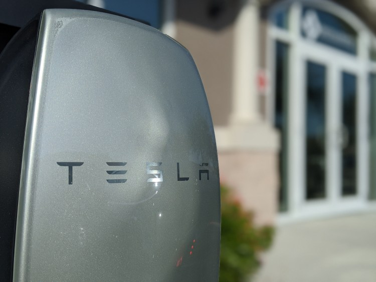 Tesla Wall Charger in front of law office of Smith Hopen PA