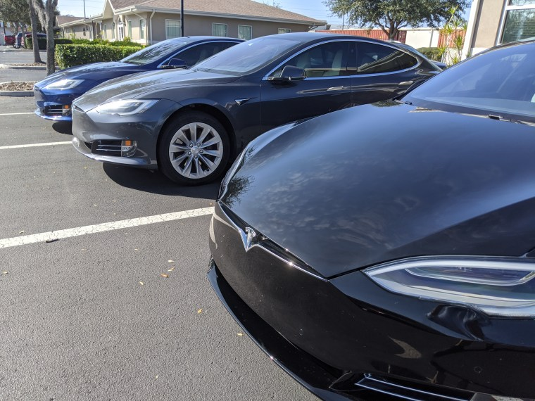 Three Tesla Model S vehicles parked