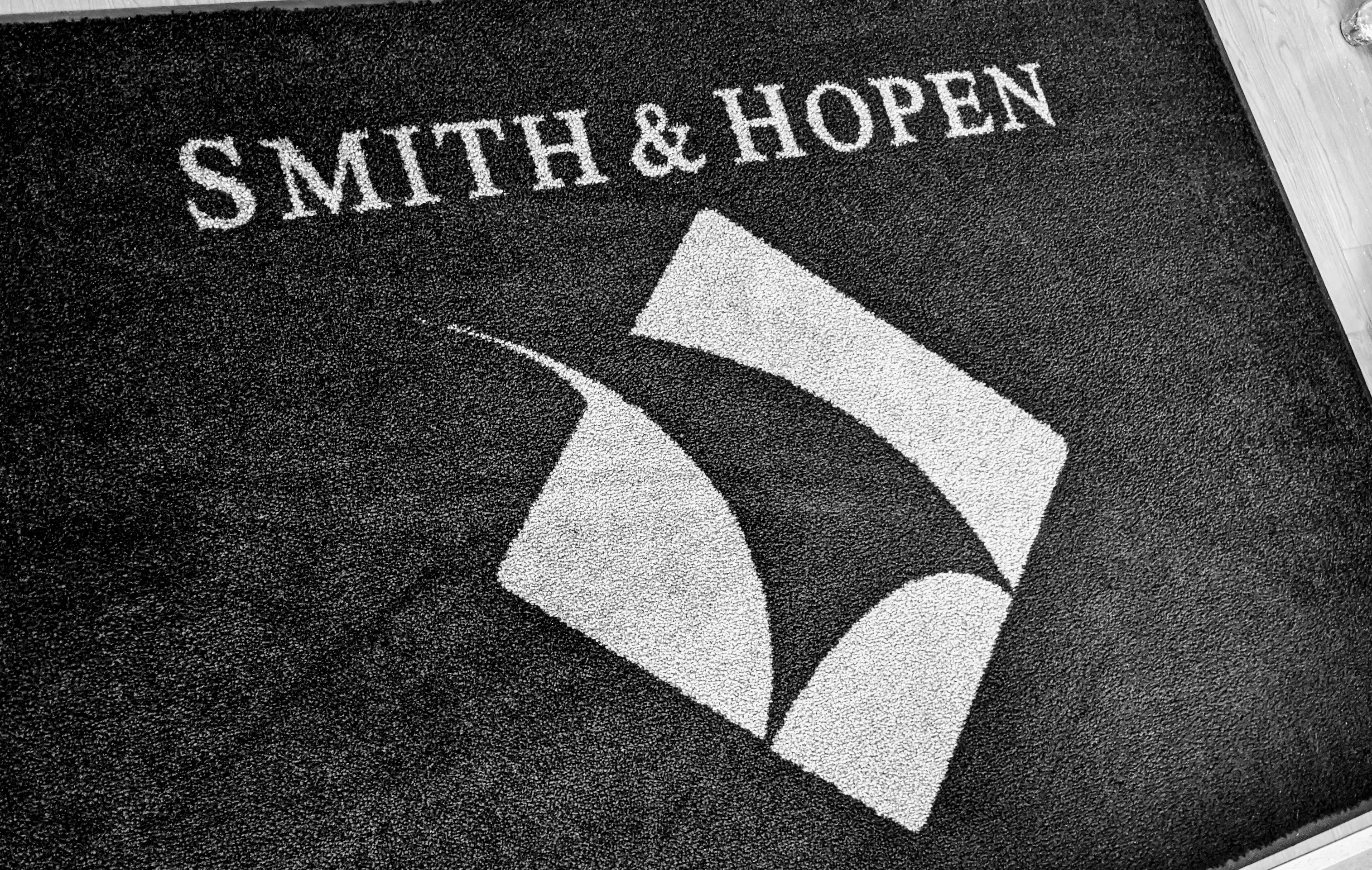 Branding of Smith & Hopen trademark on welcome mat at Oldsmar Office