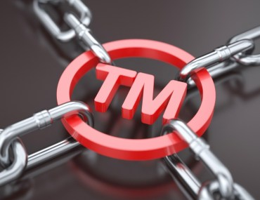 Trademark symbol locked in chains - trademark protection.