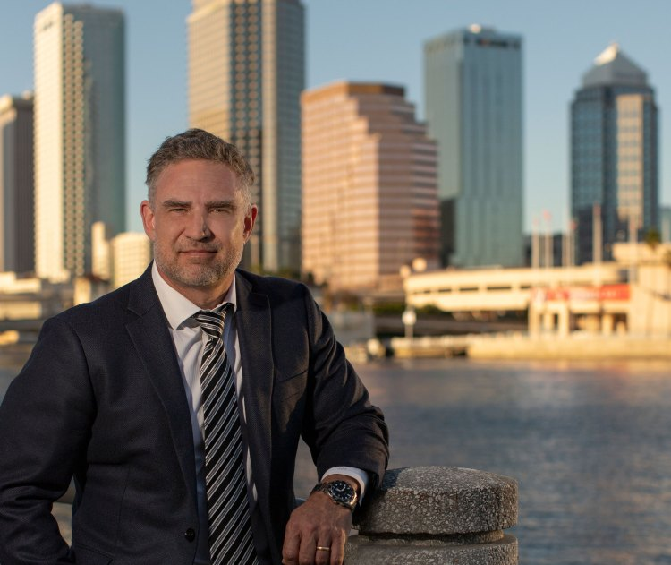 Patent attorney Anton Hopen in front of Tampa skyline, February 2021.