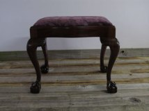 Mahogany stool with ball and claw feet, has been reupholstered £80