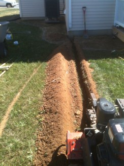Digging a ditch for an underground drainpipe