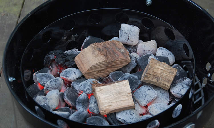 Wood chunks over charcoal