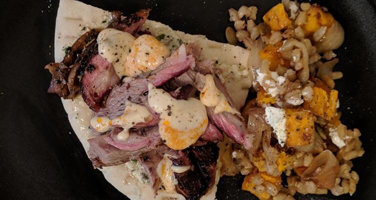 Smoked lamb shoulder on pita with hummus