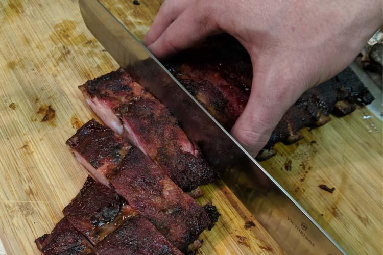 Victorinox grant knife slicing pork ribs