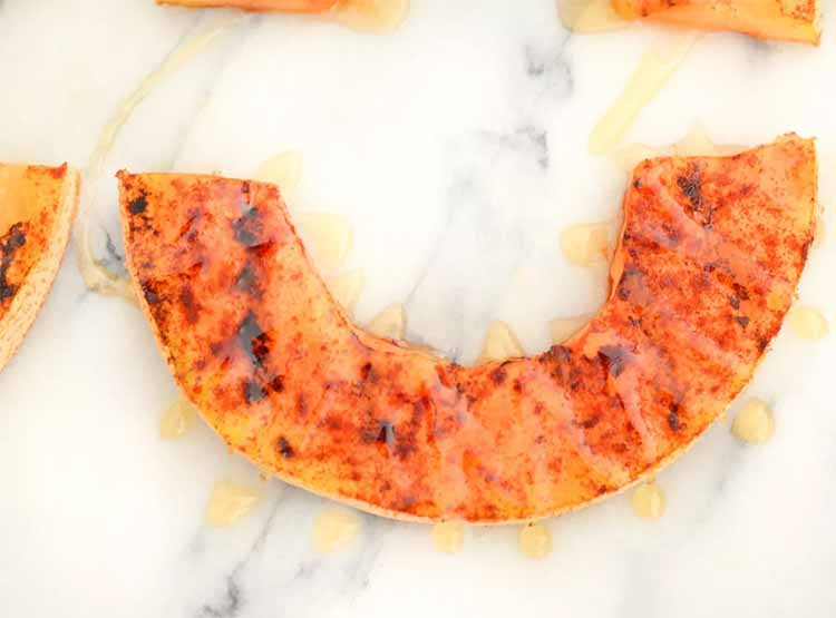 Grilled cantaloupe with drizzled honey
