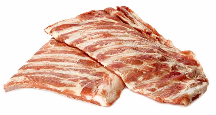 Raw pork spare ribs on a white background