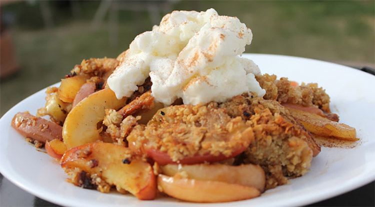 barbecued apple crisp topped with cream