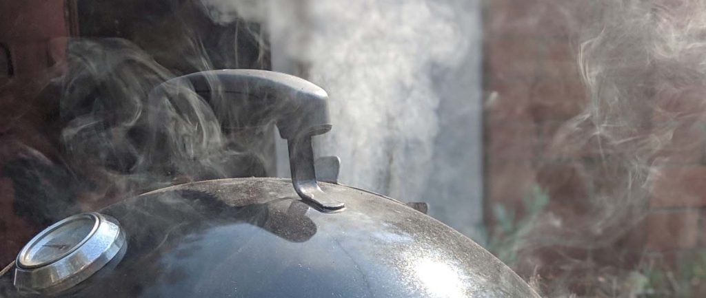 Smoke coming out of a smoker